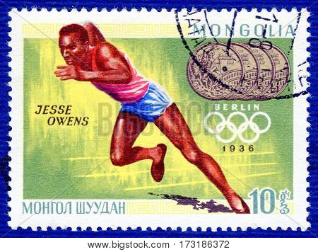 MONGOLIA - CIRCA 1960: Postage stamp printed in Mongolia with a picture of Jesse Owens (Athletics), from the series