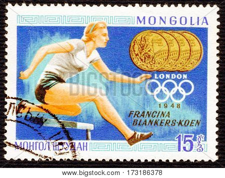 MONGOLIA - CIRCA 1960: Postage stamp printed in Mongolia  with a picture of Francina Blankers-Koen (Athletics), from the series