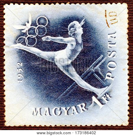 HUNGARY - CIRCA 1952: Postage stamp printed in Hungary  with a picture of a gymnastics, from the series