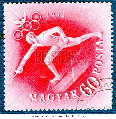 HUNGARY - CIRCA 1952: Postage stamp printed in Hungary  with a picture of a fencing, from the series