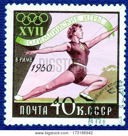 USSR - CIRCA 1960: Postage stamp printed in USSR  with a picture of a gymnastics, from the series