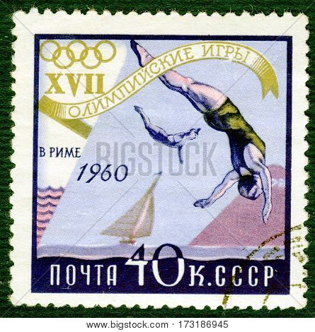 USSR - CIRCA 1960: Postage stamp printed in USSR  with a picture of a jumping into water, from the series