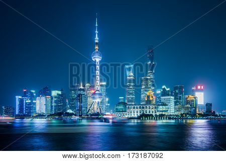 City skyline lit up at night Shanghai China