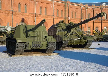 ST. PETERSBURG, RUSSIA - JANUARY 20, 2017: Two self-propelled artillery cannons of ISU-152 and Msta-S in the January evening. Artillery museum of St. Petersburg