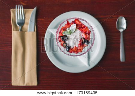 Fresh cottage cheese with juicy berries raspberries, breakfast in restaurant, close up, top view