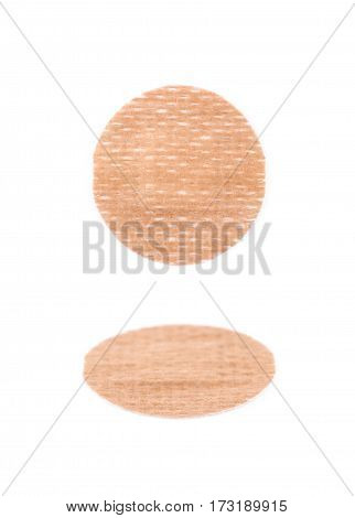 Adhesive bandage sticking plaster isolated over the white background, set of two different foreshortenings