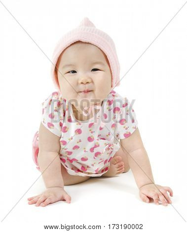 Portrait of full length happy Asian baby girl in pink clothes crawling on floor, isolated on white background.