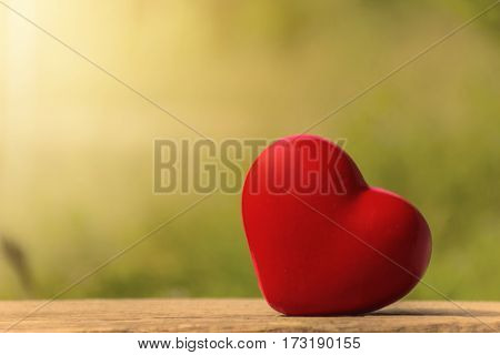 The heart as a symbol of love valentines day background;lighting effect vintage style