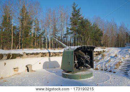 KRASNOFLOTSK, RUSSIA - FEBRUARY 08, 2017: Naval guns of the period Great Patriotic War on a position in the winter afternoon. Fort Krasnaya Gorka