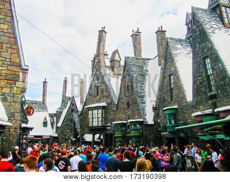 Orlando, United States of America - January 02, 2014: Visitors enjoying the Harry Potter themed attractions and shops at the Hogsmeade Village inside Universal Studios Islands of Adventure theme park