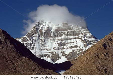 Cloud on the top of of sacred Mount Kailash early in the morning.