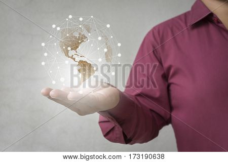 Businessman diagram statistic Media worldwide technology concept and hand support world map Using modern technologies for business ./ Show through hand for support technology