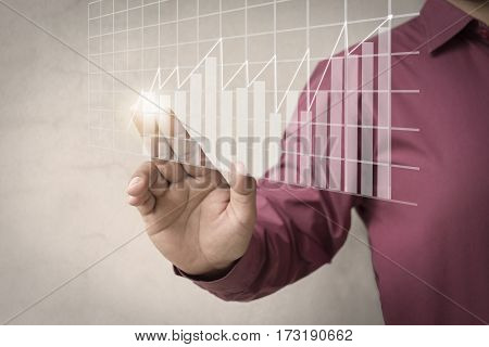 A businessman offering chart business diagram statistic , Using modern technologies for business ./ Show through hand for support stock financial graph. Mixed media