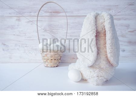 easter bunny and eggs on white wooden background