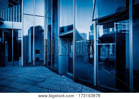 exterior of glass office building with reflection.