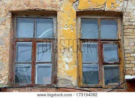 Vintage window of old abandoned building with dirty glass