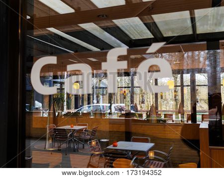 Modern Classical Design Coffee Shop Cafe Restaurant Blurred Sign on Glass Window