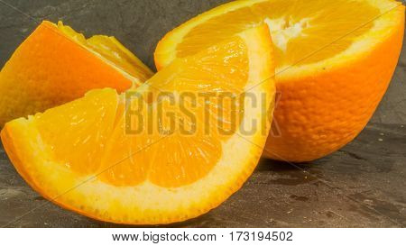 Fresh oranges on a background of slate