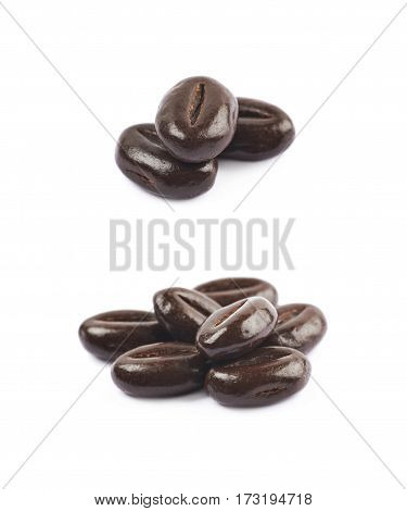 Pile of coffee bean shaped chocolate candies isolated over the white background, set of two different foreshortenings