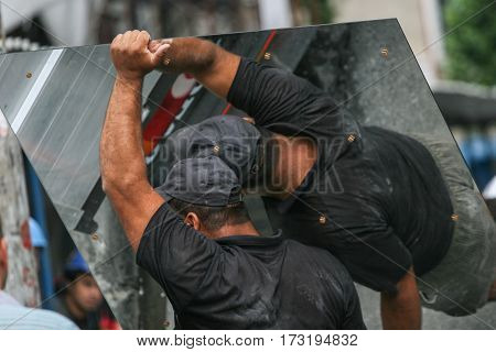 Laborers Carrying Mirrors