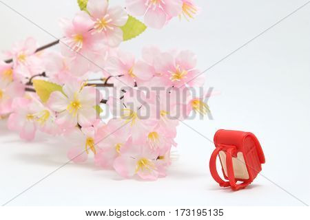 Schoolchild's rucksacks and cherry blossoms on white background. randoseru. Entrance ceremony consept.