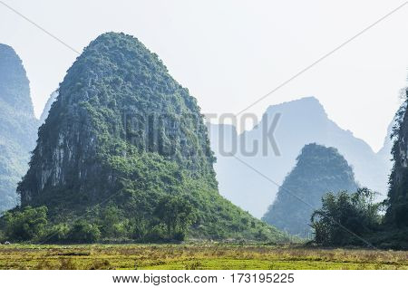 The karst mountains and countryside scenery in autumn