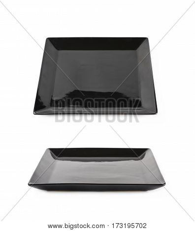 Black ceramic square shaped plate isolated over the white background, set of two different foreshortenings