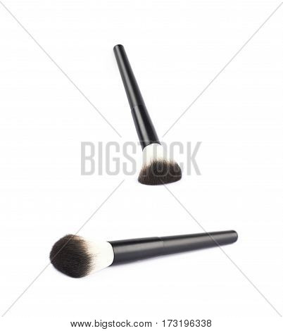 Wide make-up brush isolated over the white background, set of two different foreshortenings