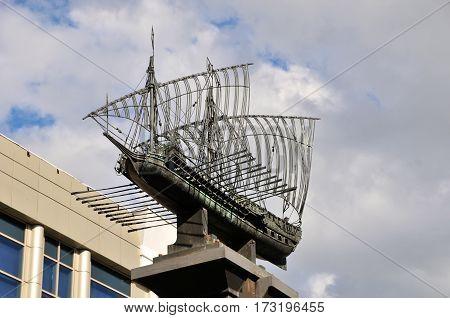 Kazan, Tatarstan, Russia - August 16, 2016. Street Peterburgskaya - partially pedestrianized street in the historical center of Kazan, one of the city's landmarks. Modern stylized sculpture of a ship.