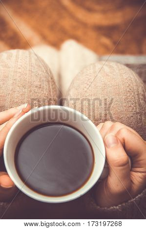 Woman with holding white cup of hot coffee warm