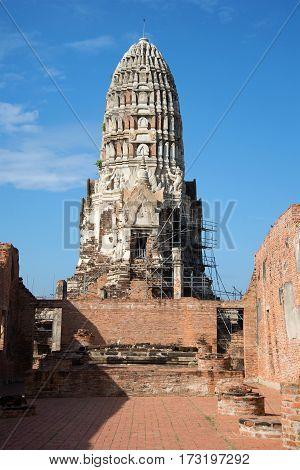 Ancient prang Buddhist temple of Wat Ratcha Burana sunny day. Ayutthaya, Thailand