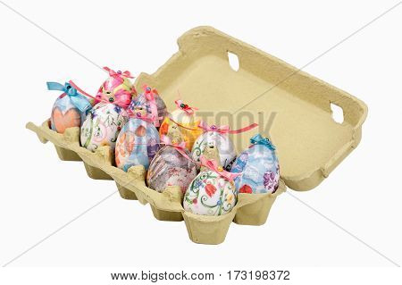 Colorful Easter eggs in egg box isolated on white