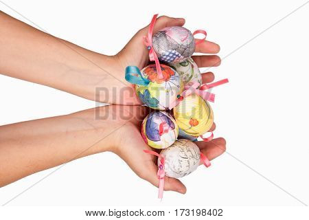 Colorful easter eggs in child hands isolated on white