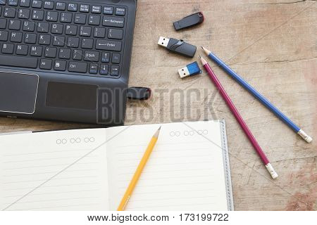 computer with flash memory and notebook planner for business on office desk