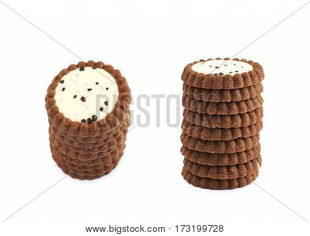 Pile of chocolate cookies with a cream filling isolated the white background, set of two different foreshortenings