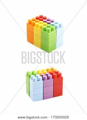 Wall made of plastic construction toy bricks isolated over the white background, set of two different foreshortenings