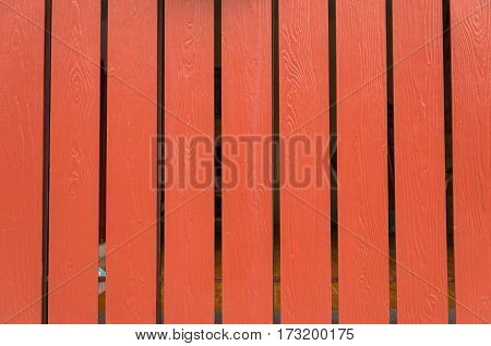 coral orange old wooden fence. wood palisade background. planks texture