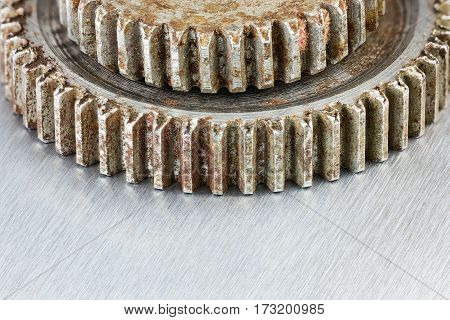 Rusty Weathered Industrial Gears On Scratched Metal Background