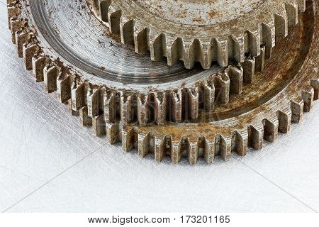 Rusty Weathered Metal Gears On Scratched Industrial Background