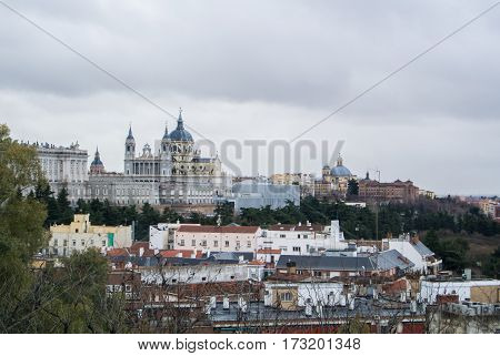 A panoramic view to Royal Palace of Madrid and its surroundings on cloudy winter day Madrid Spain.