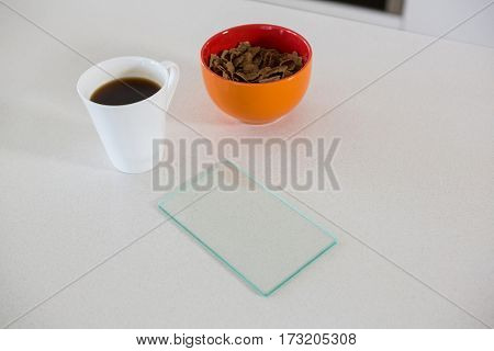 Breakfast bowl with coffee mug in kitchen at home