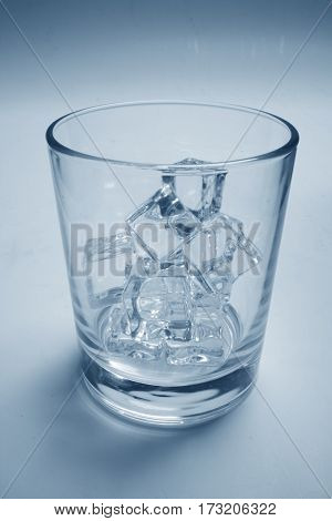 glass with ice cubes
