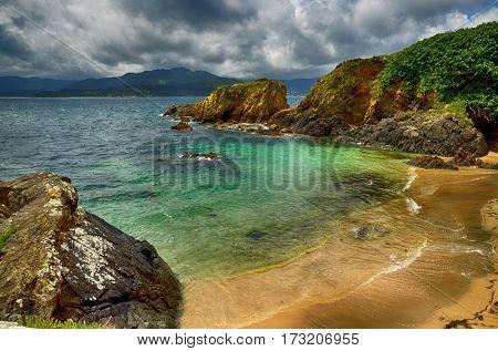 Ocean coast in the north west of Spain, Galicia region, little town of Porto de Espasante, urban beaches detail