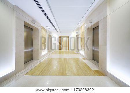 Empty white hall with elevator doors in modern business center
