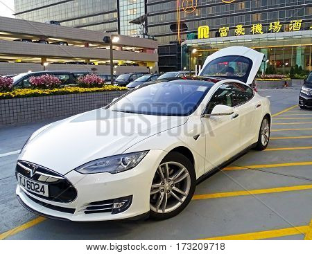 Chek Lap Kok, Hong Kong - February 8, 2016: An electric vehicle model S of the brand Tesla Motors parked at the airport in Chek Lap Kok, Hong Kong.