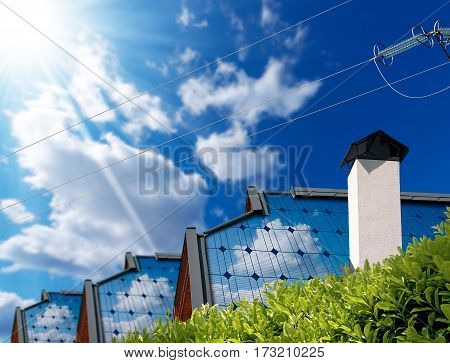 Close-up of roofs of houses with solar panel and a power line on a blue sky with clouds and sun rays. Concept of solar energy
