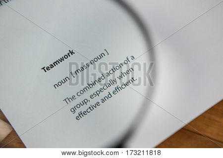 Close-up of teamwork text written on paper