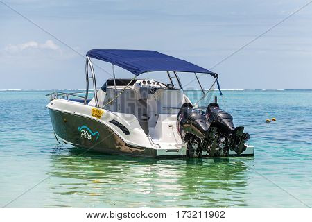 Le Morne Mauritius - December 7 2015: A sunny day with speed boat on the Le Morne Beach one of the finest beaches in Mauritius and the site of many tourism facilities.