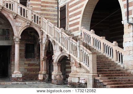 Staircase of reason in courtyard the Palazzo della Ragione. Verona Italy
