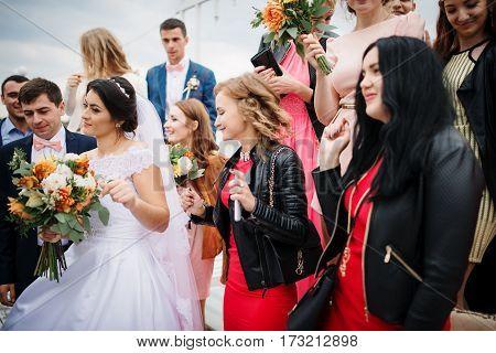 Zastavna, Ukraine - September 25, 2016: Wedding Couple With With A Crowd Of Friends Having Fun.